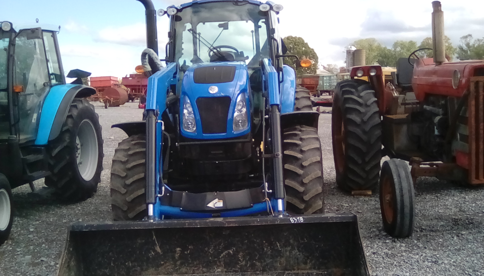 NEW HOLLAND TS6.120 TRACTOR 4X4 W/ CAB W/ LOADER Image