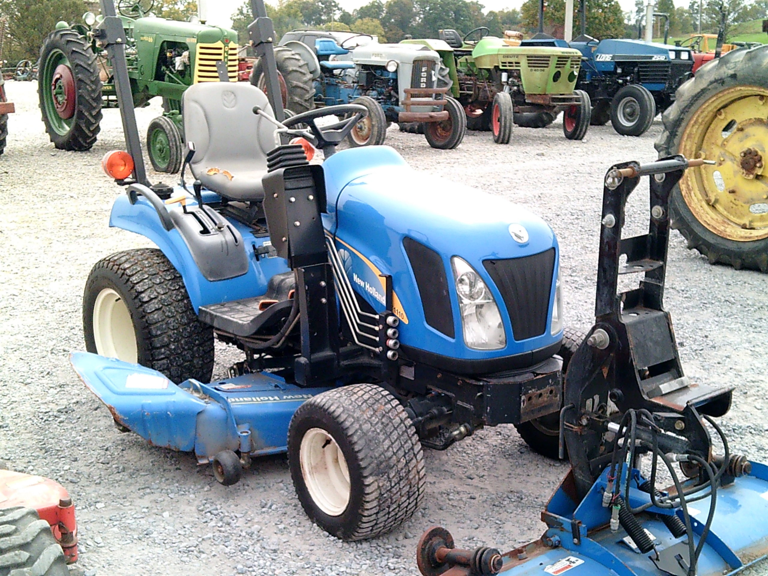 NEW HOLLAND T1110 W/ FRONT BLADE Image