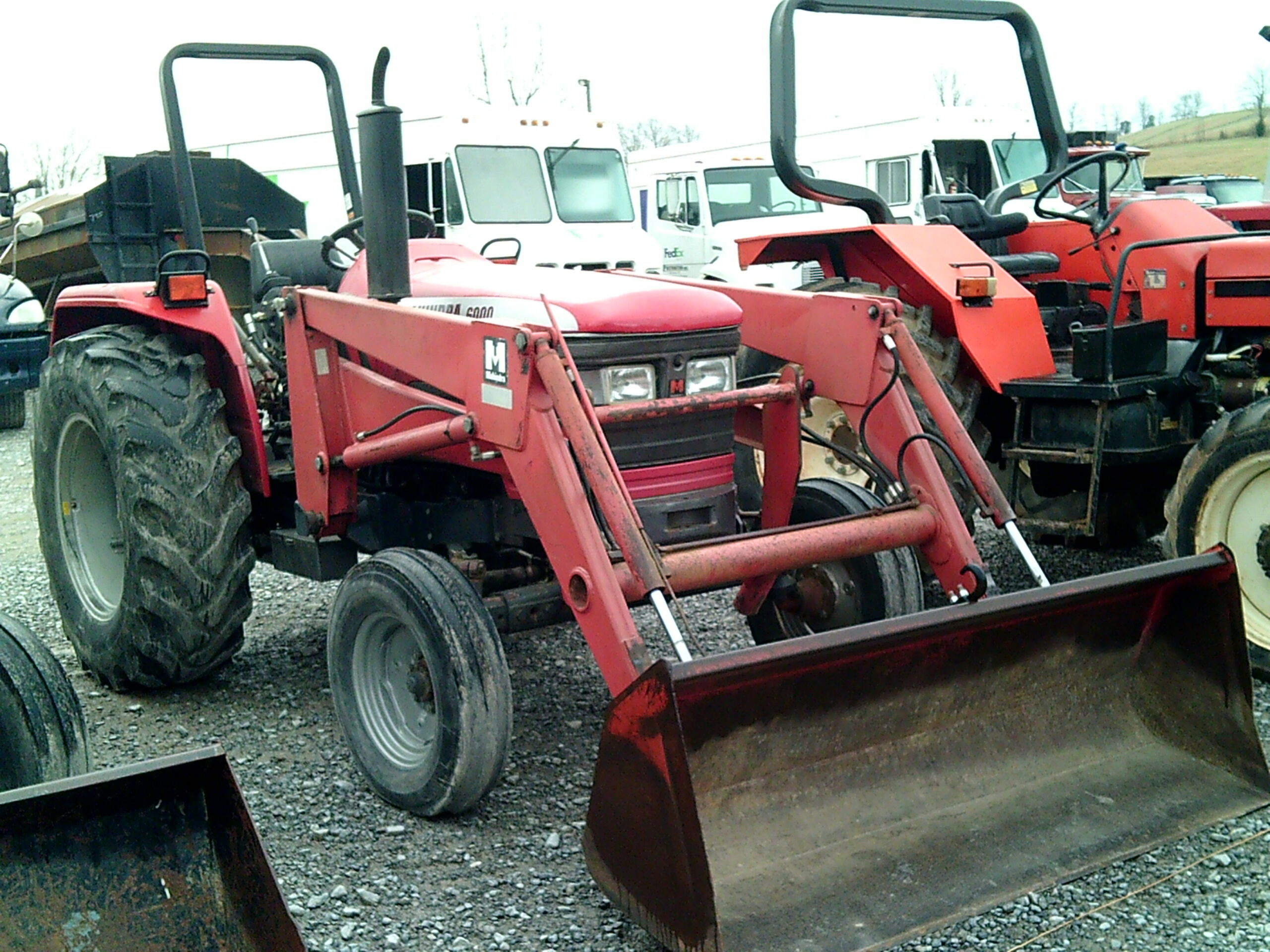 MAHINDRA 6000 TRACTOR WITH FRONT END LOADER Image